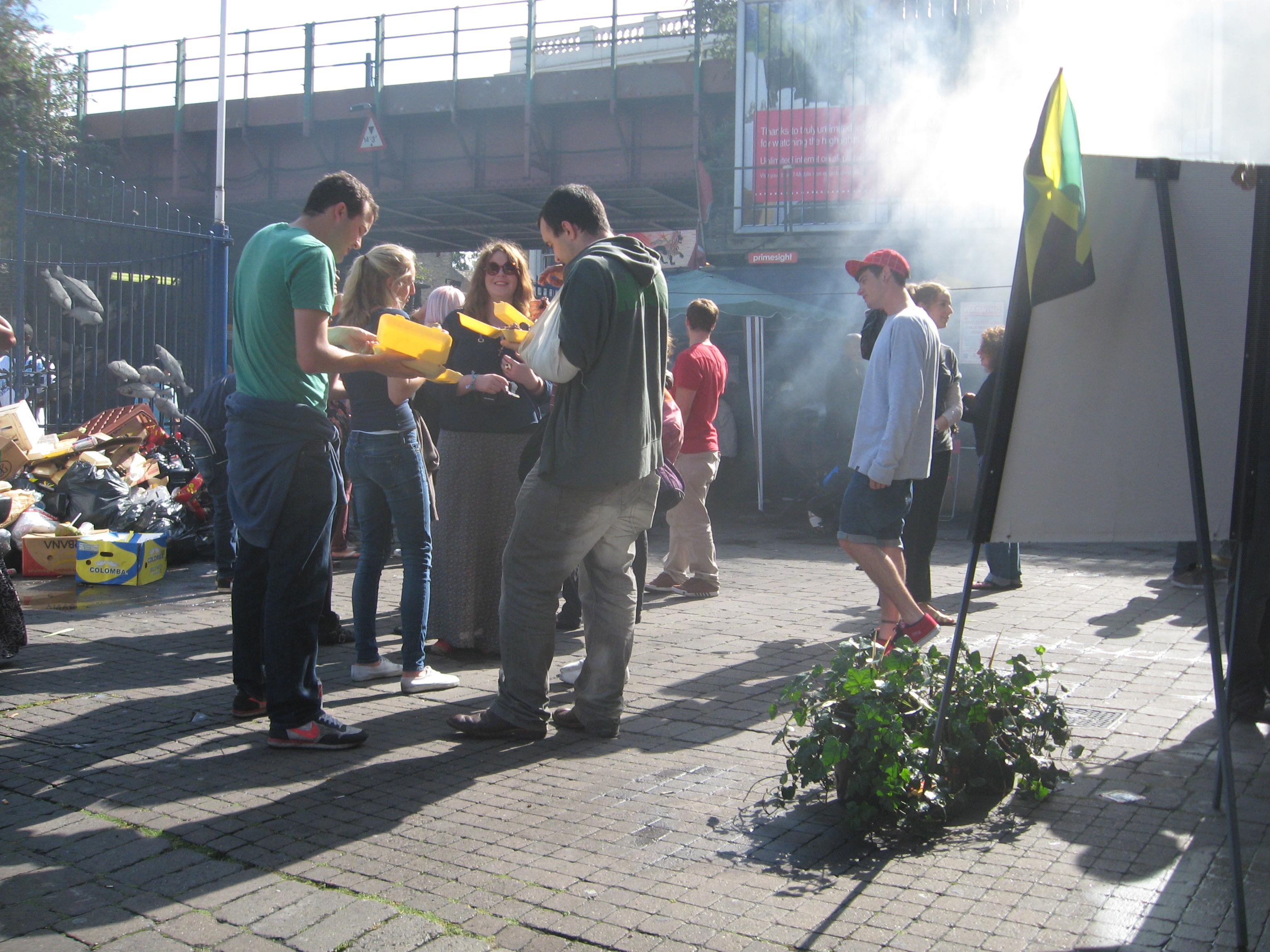 people eating food in street